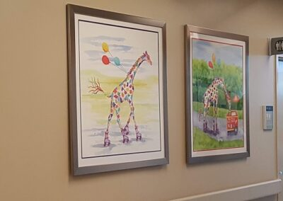 Two Rhonda Leonard paintings hanging on a wall